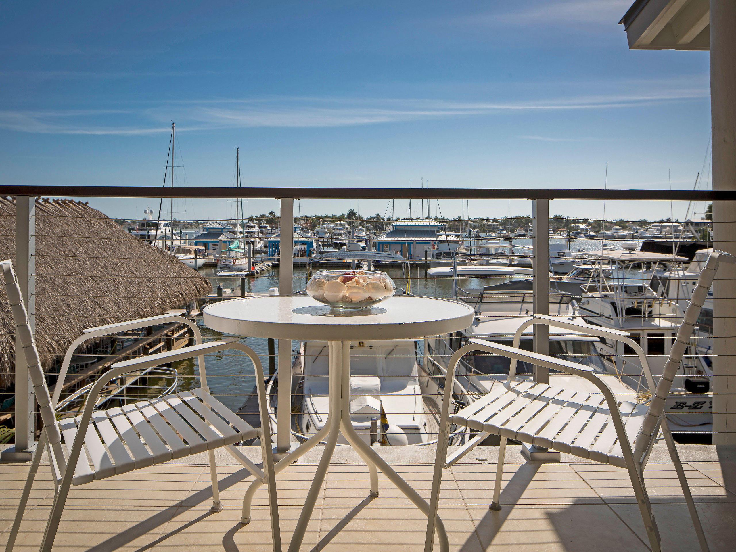Patio set on balcony with harbor views.