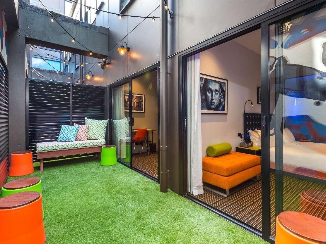 Private art-adorned courtyard with door into bedroom