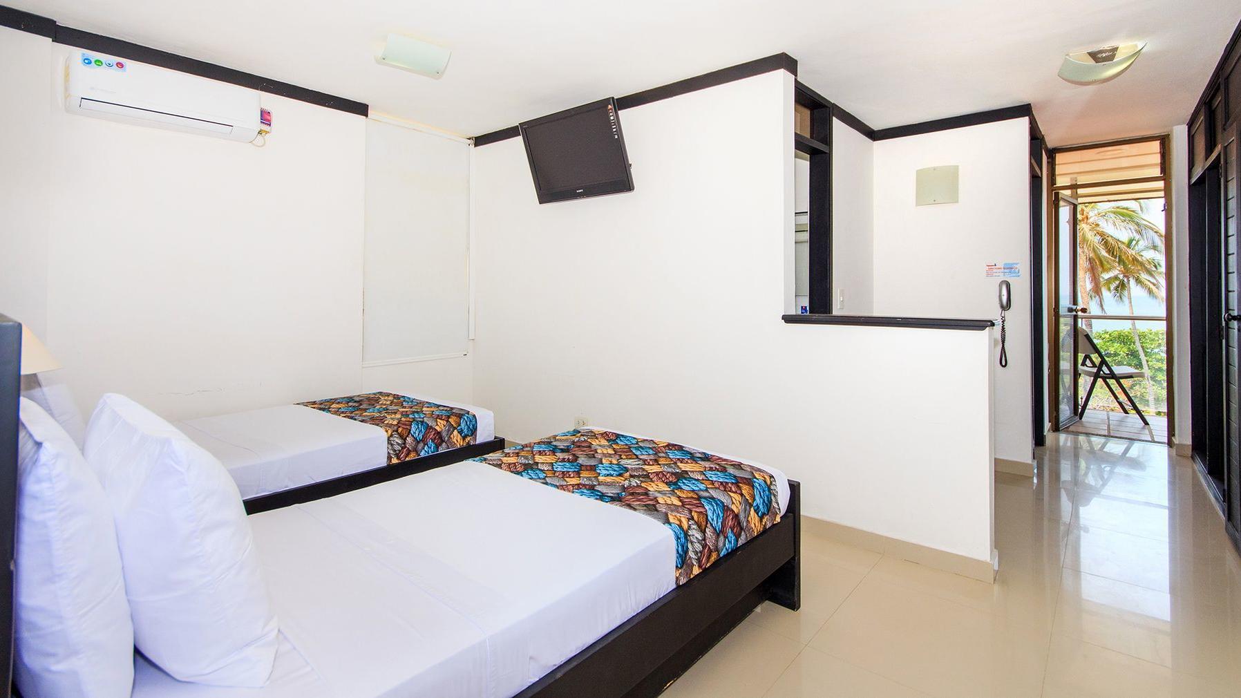 Habitación doble con camas independientes en Santa Marta