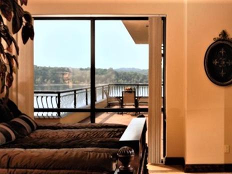 window in bedroom showing a balcony area