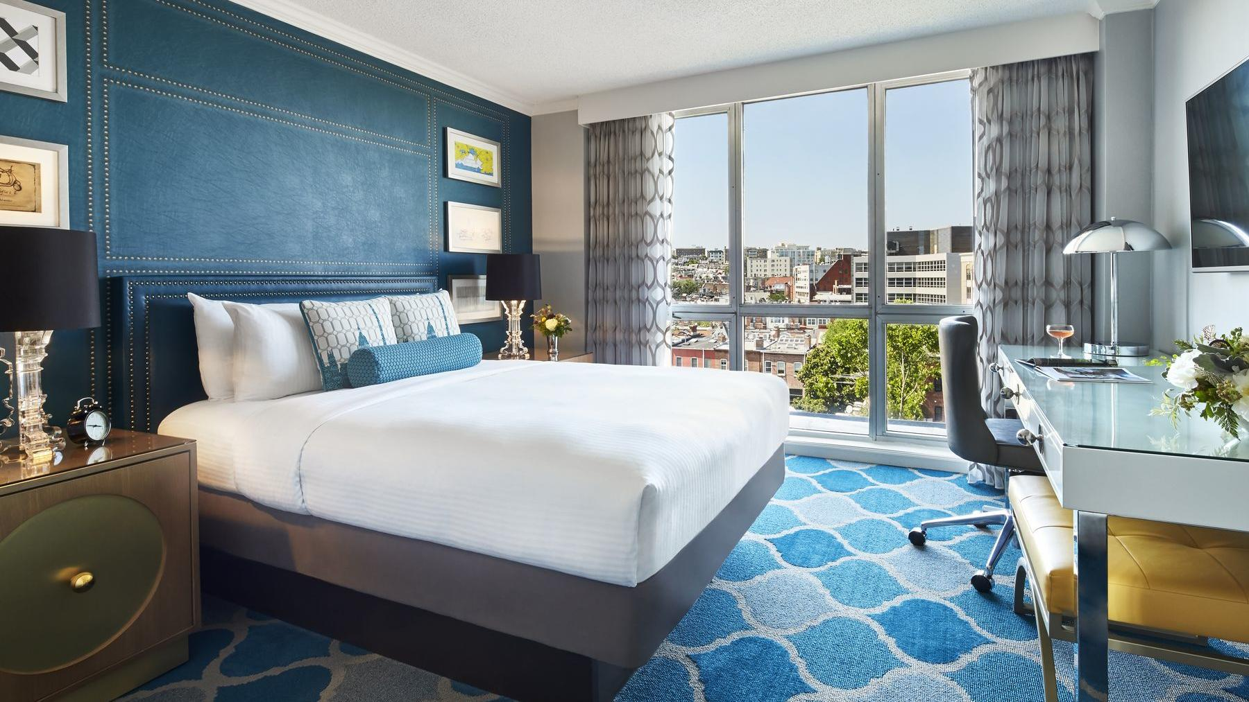 Guest room with queen bed and city view