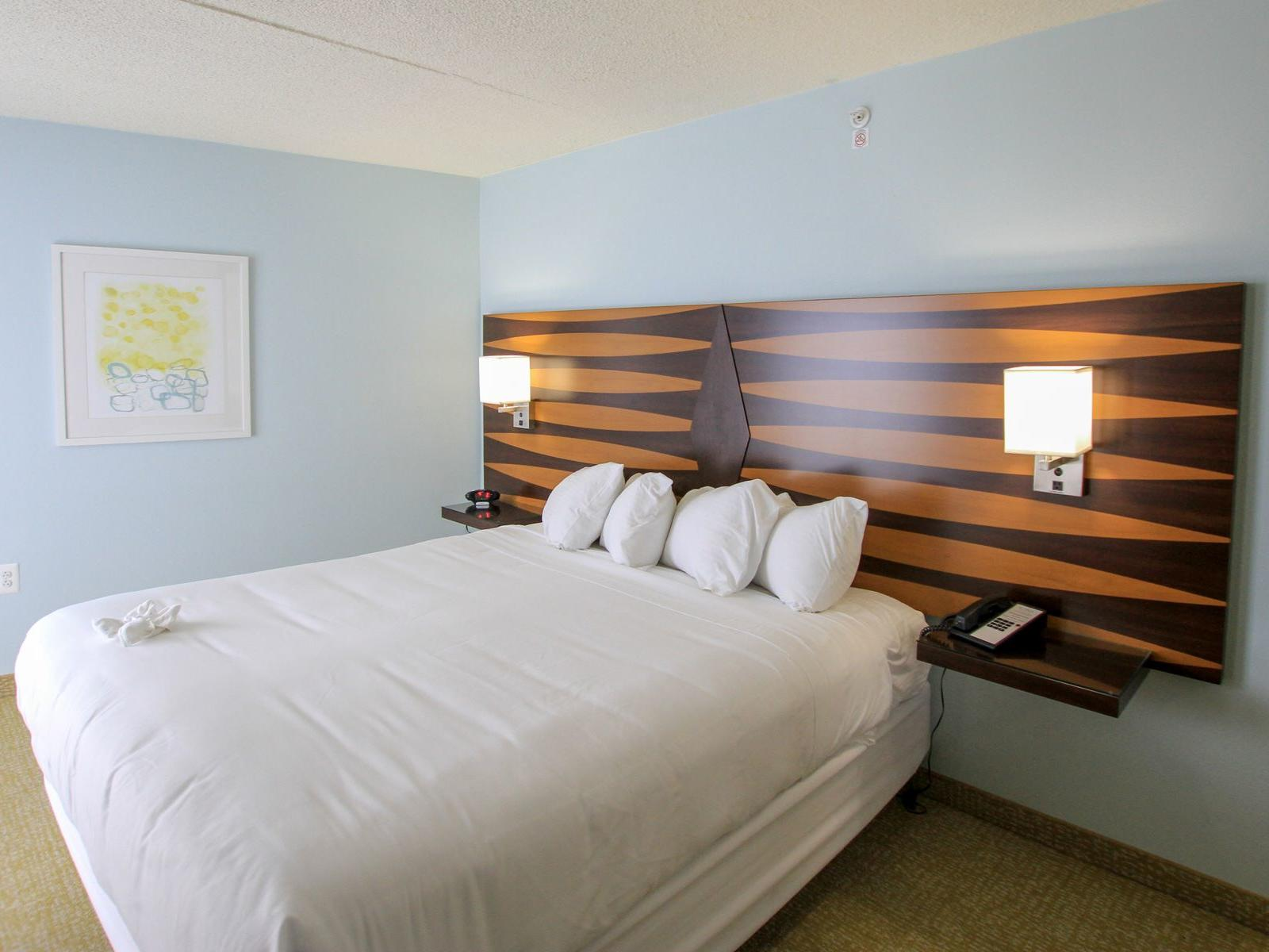 room with bed and wooden headboard