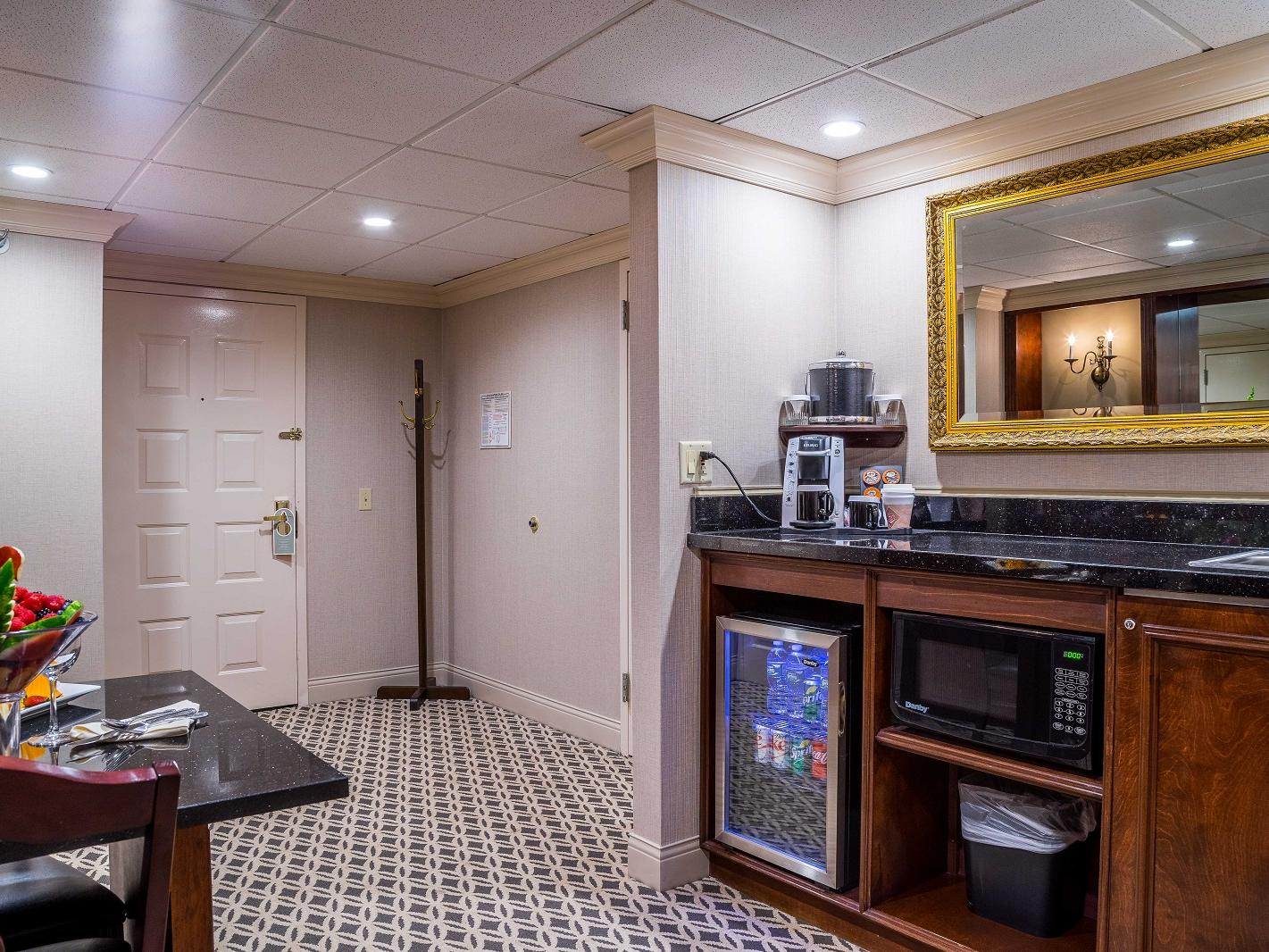 Kitchenette and dining area of presidential hotel suite