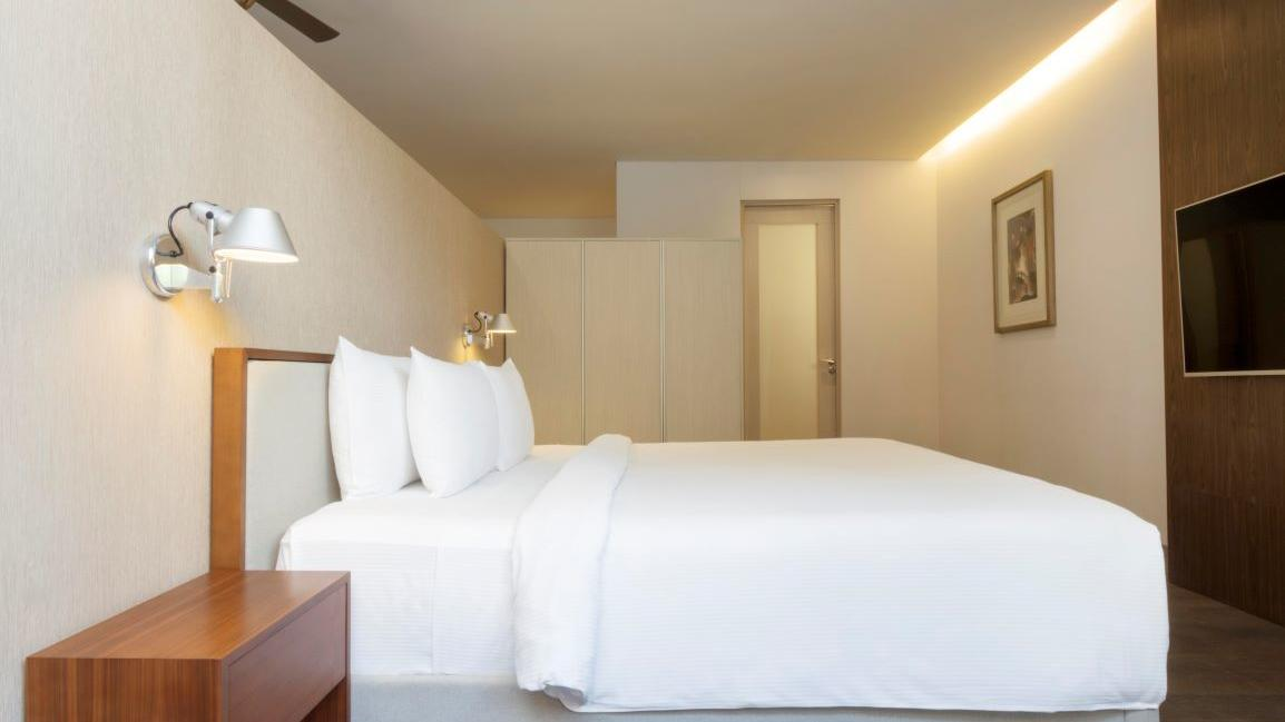 Deluxe Room white bed