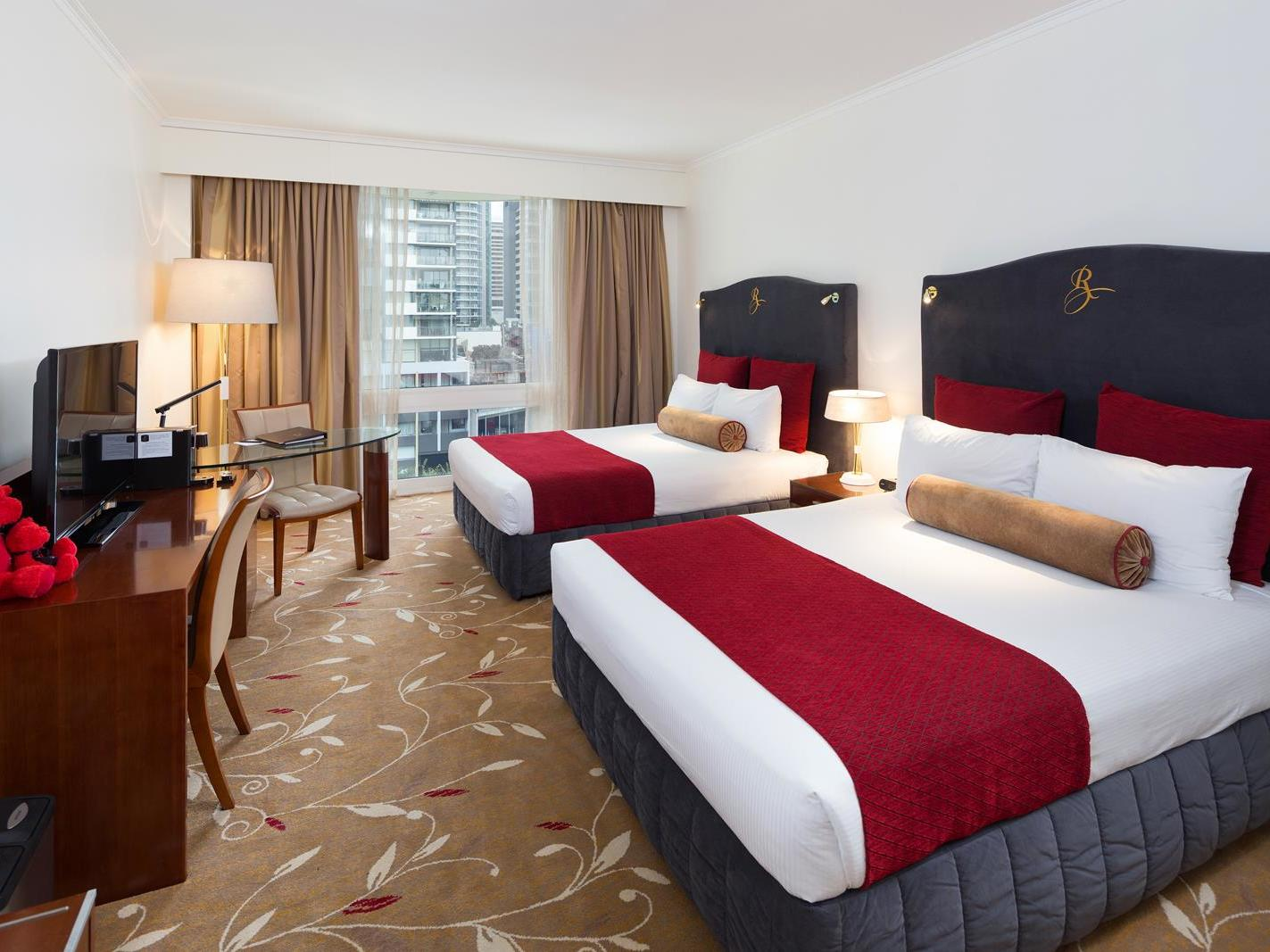 Deluxe City View Twin Room with two double beds at Royal on the Park hotel