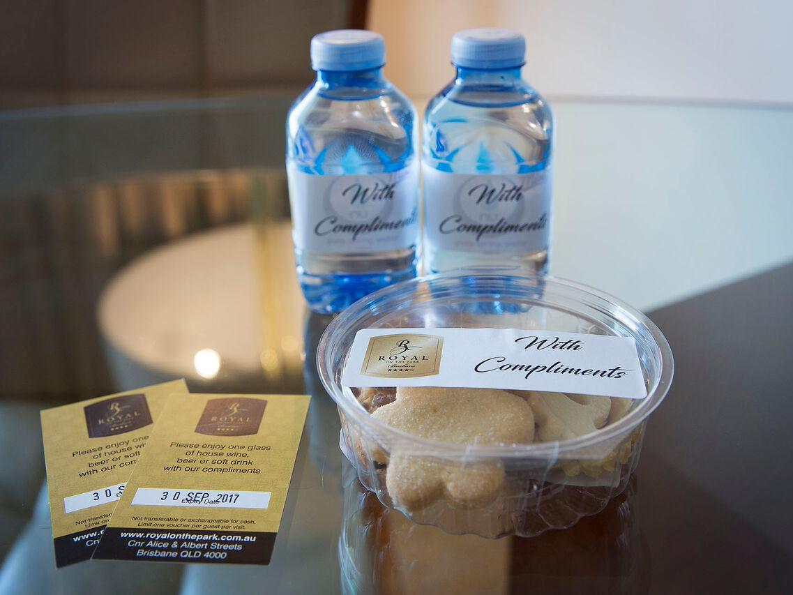 Two water bottles and snacks in Premium City View King Room at Royal on the Park hotel