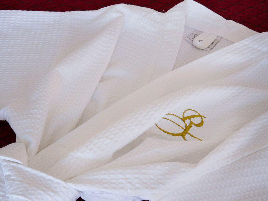 Special bathrobe in Premium City View Twin Room at Royal on the Park hotel