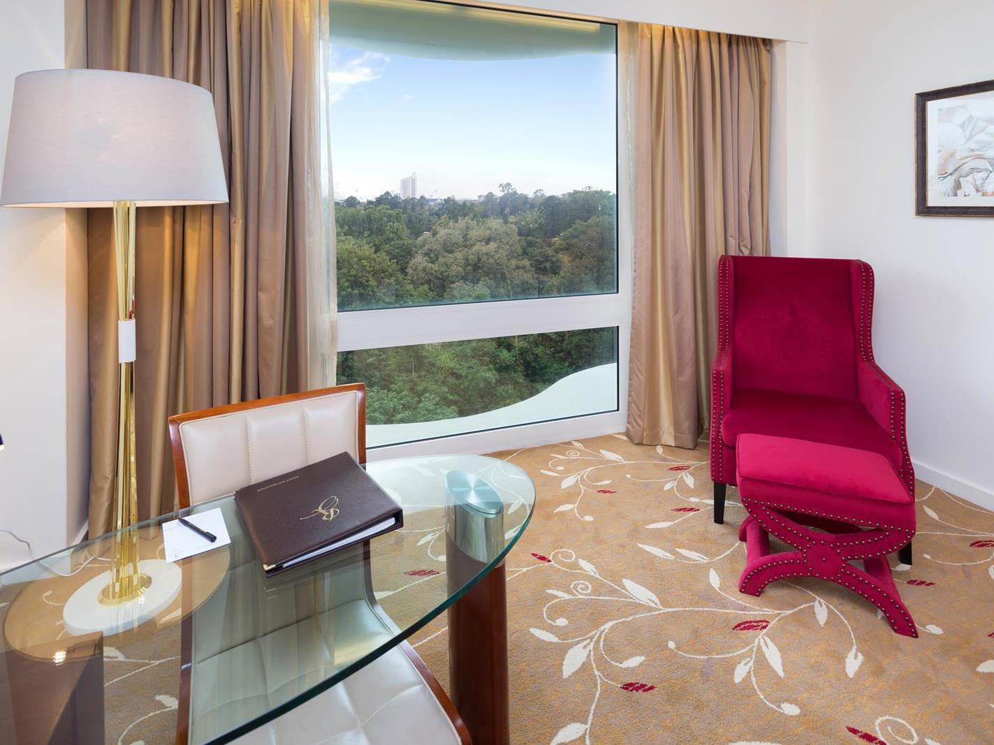 Premium City View King Room with Red chair and studying table rooms at Royal on the Park hotel