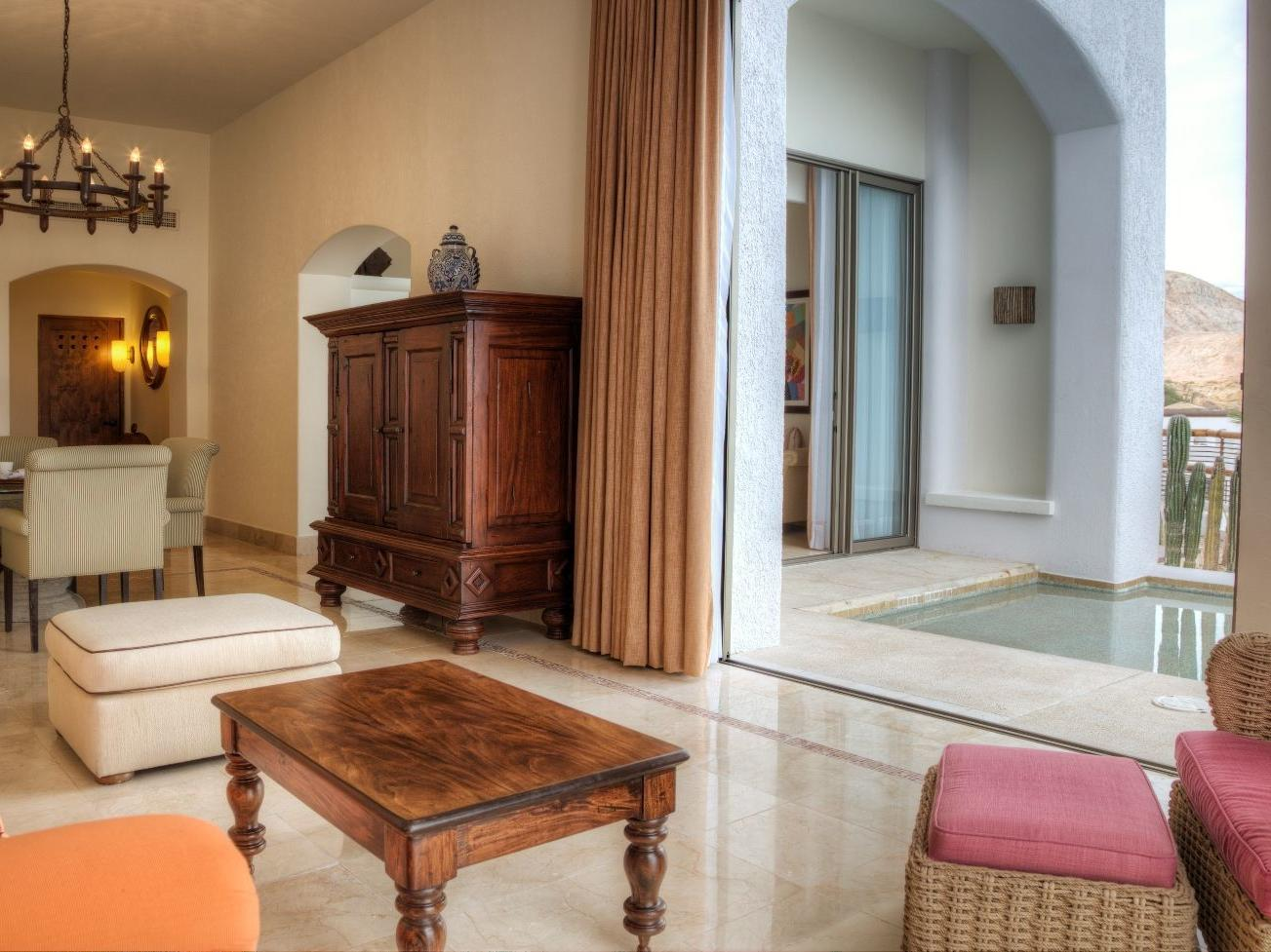A wooden table and chair in a room - Marquis Los Cabos