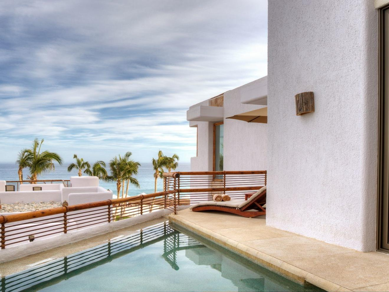 A lounge chair by a pool - Marquis Los Cabos