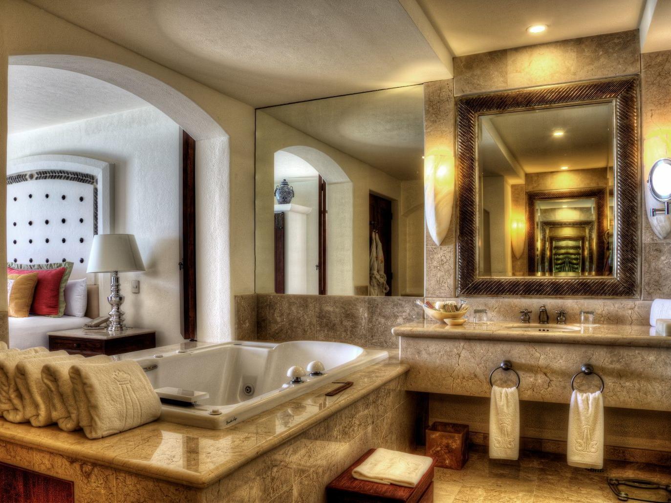 A tub and sink in a bathroom - Marquis Los Cabos
