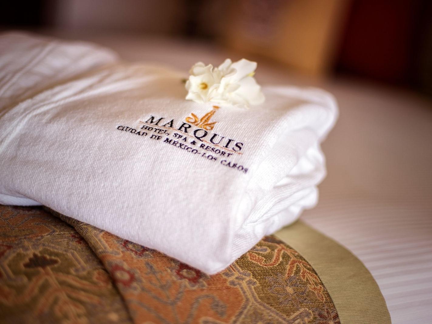 a flower on a folded bath robe