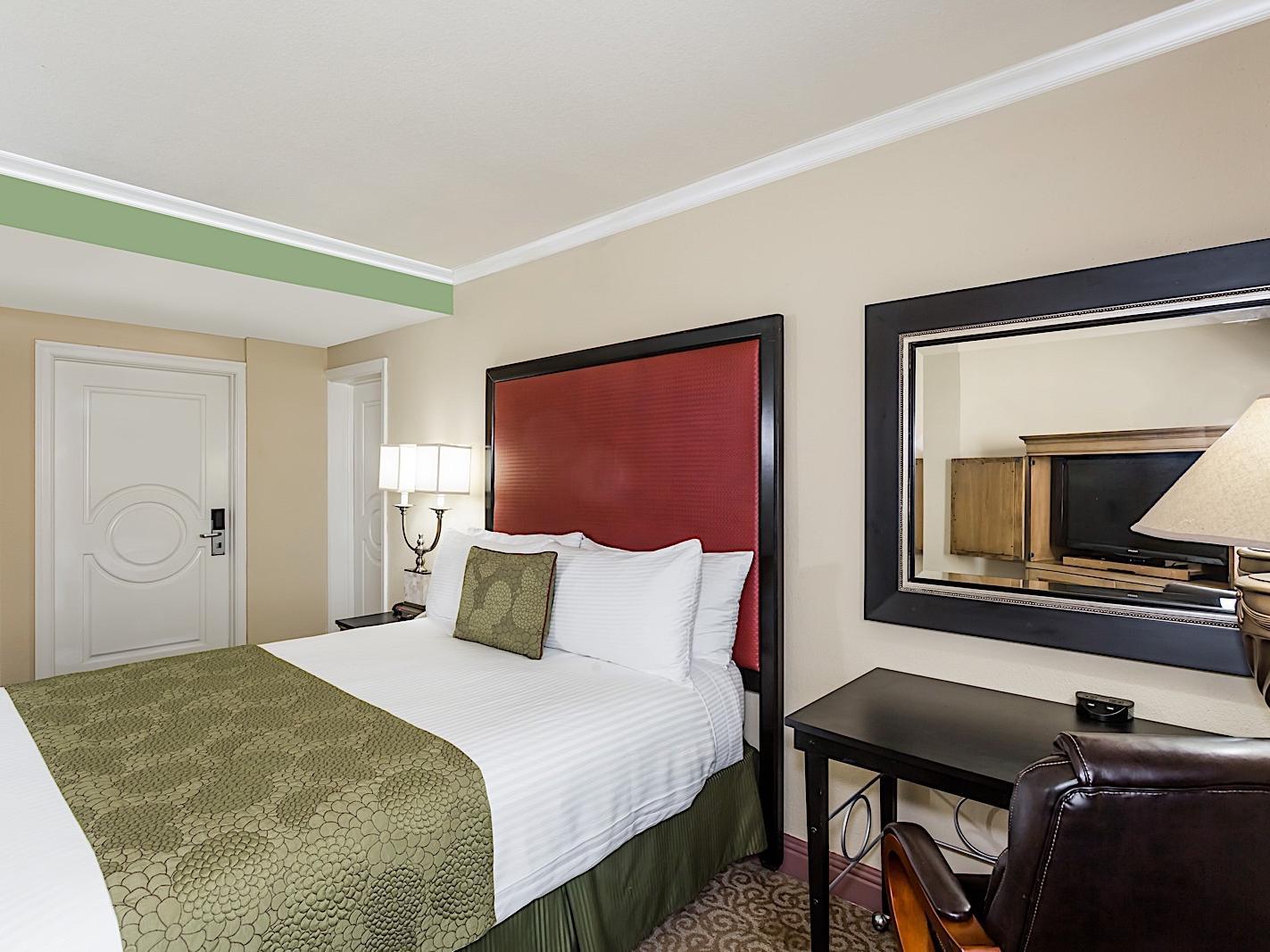 Elegant hotel room with Queen bed.