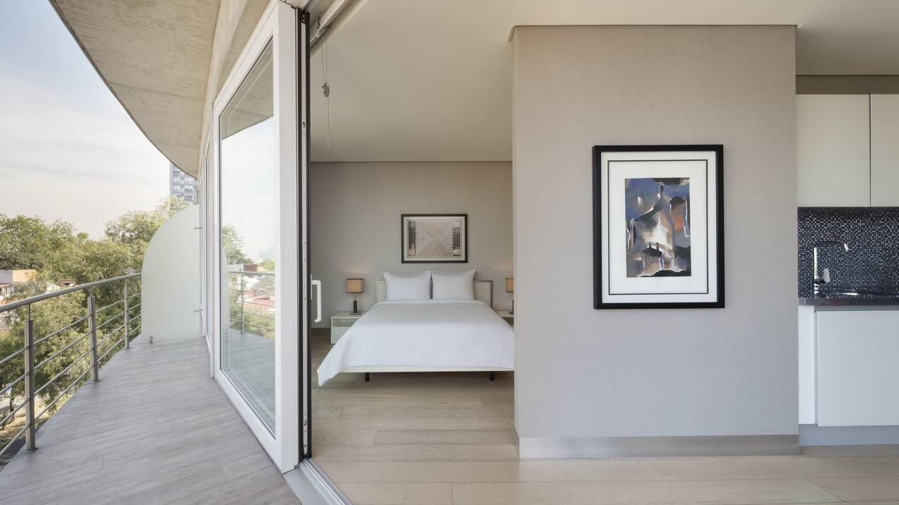bedroom with outside balcony