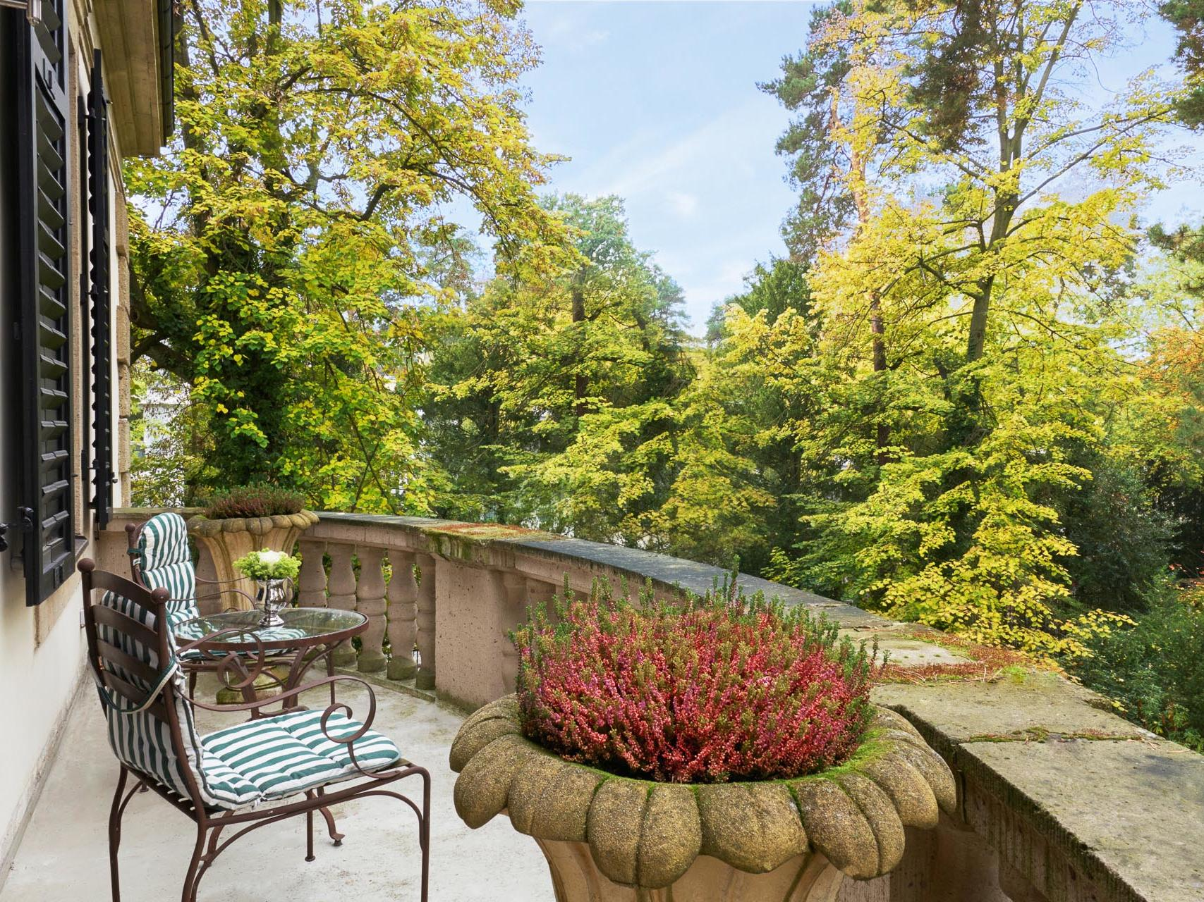 Balcony with a chair at Patrick Hellman Schlosshotel