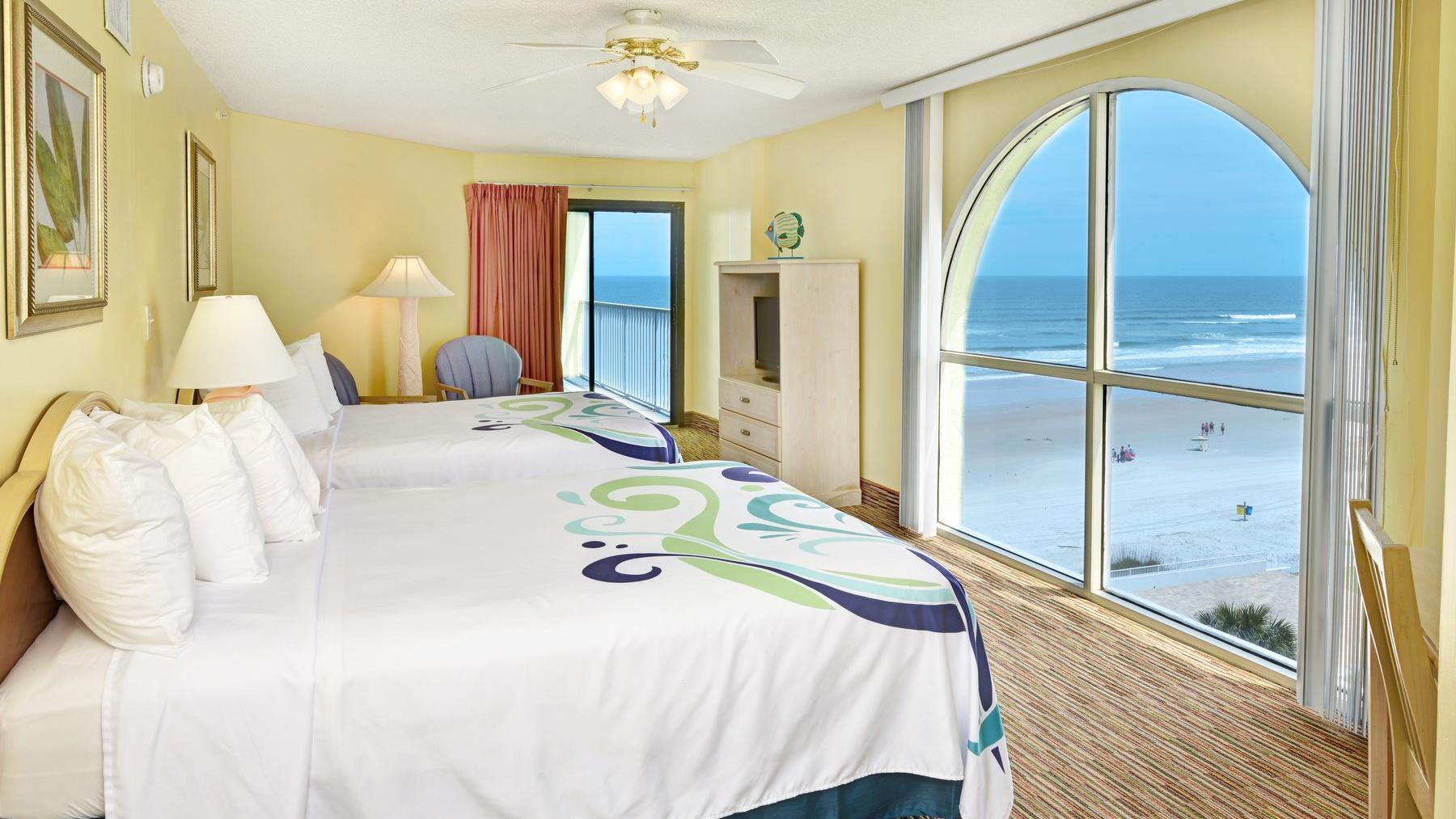 Oceanview hotel room with two beds.