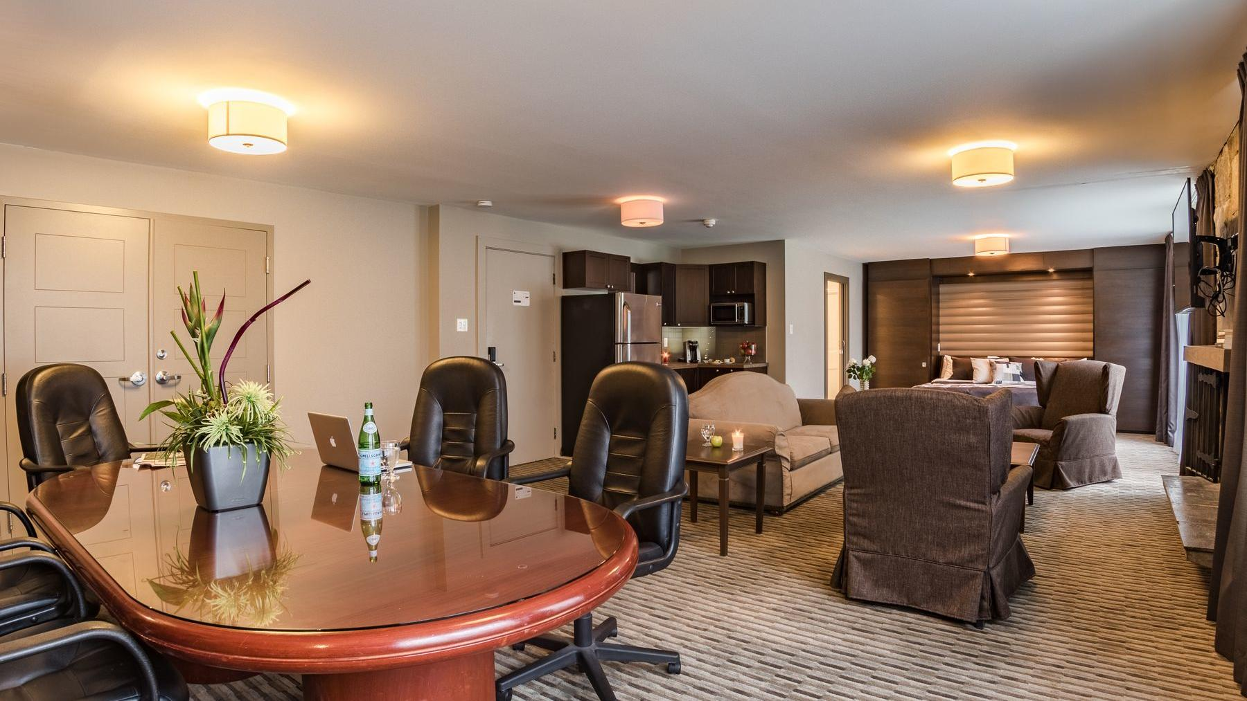 Conference table, couches, and chairs in hotel suite