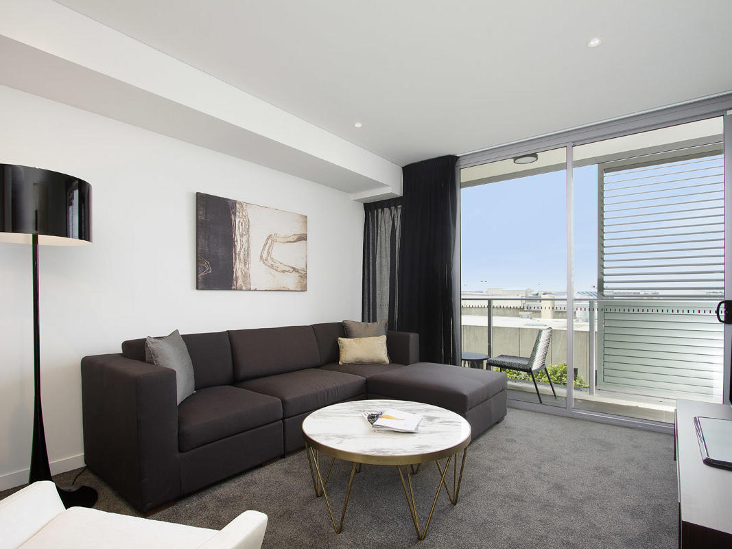 Living room in One Bedroom Balcony Room at Silkari Suites Chatswood