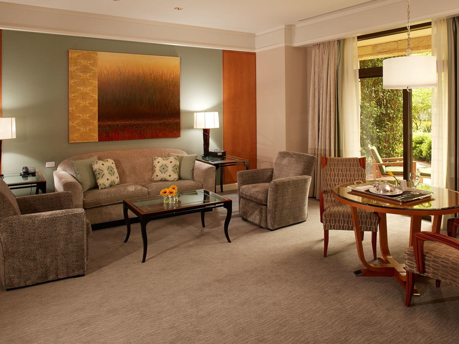 living room of hotel suite with couches and table