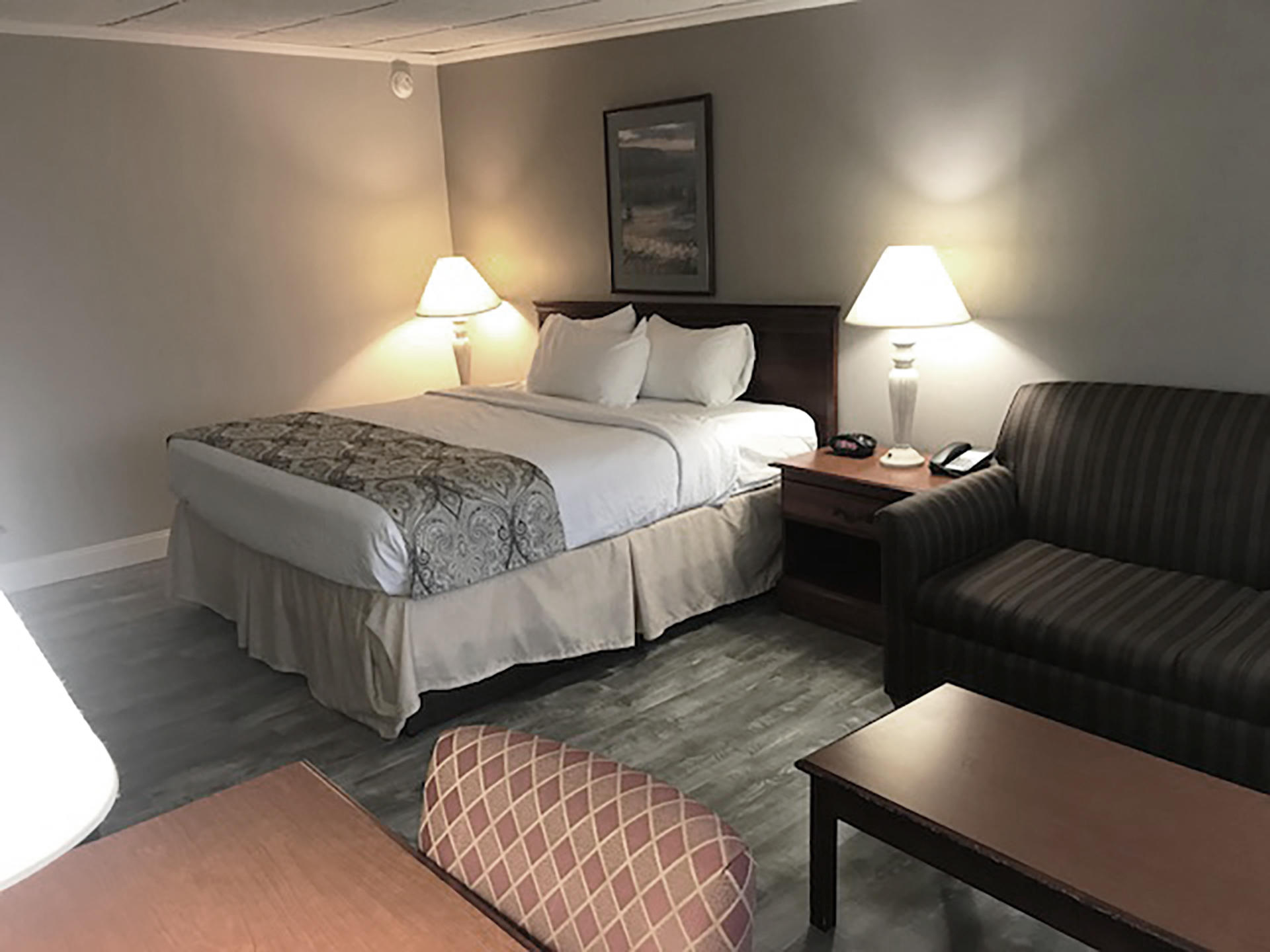 king bed in hotel room with couch