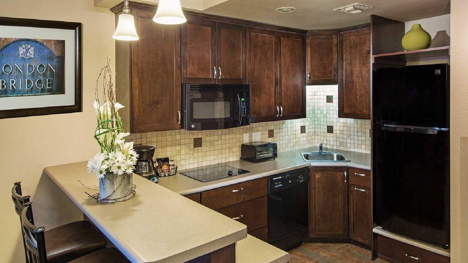 Resort suite kitchenette with bar.
