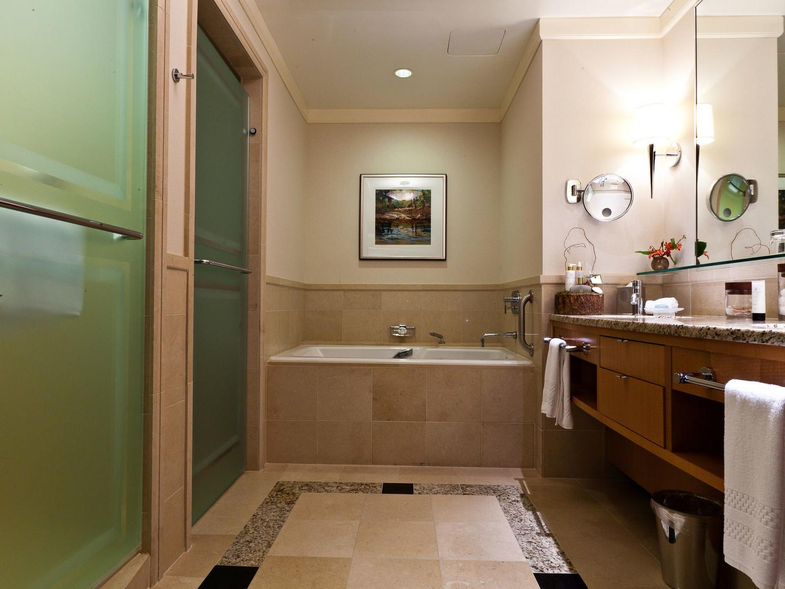 bathroom of hotel room with tub