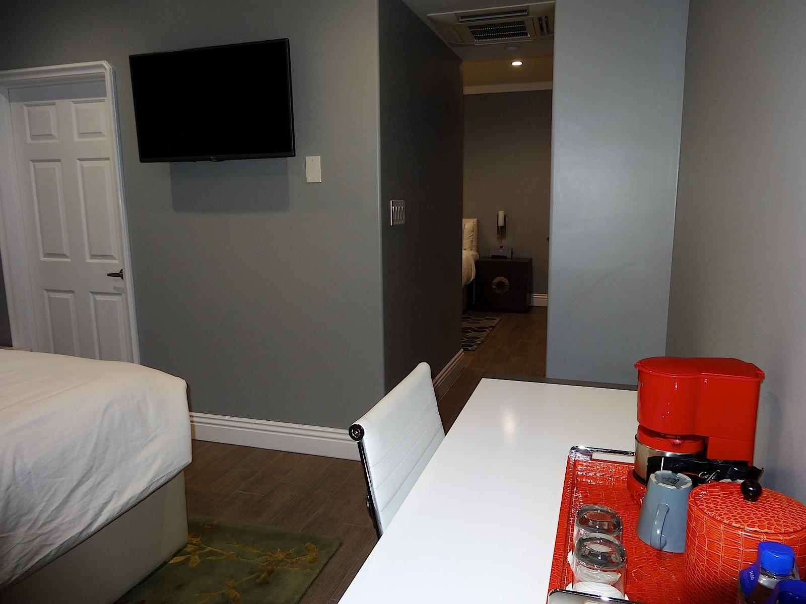 view of flat-screen tv and desk in family suite