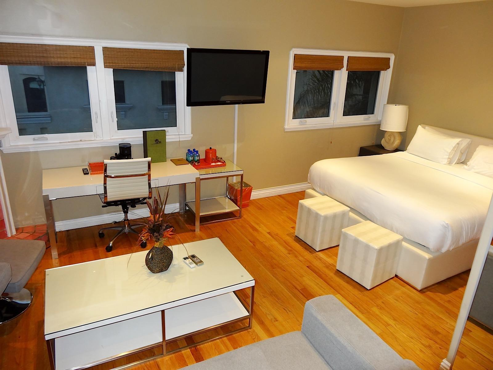 bright suite with couch, desk and bed