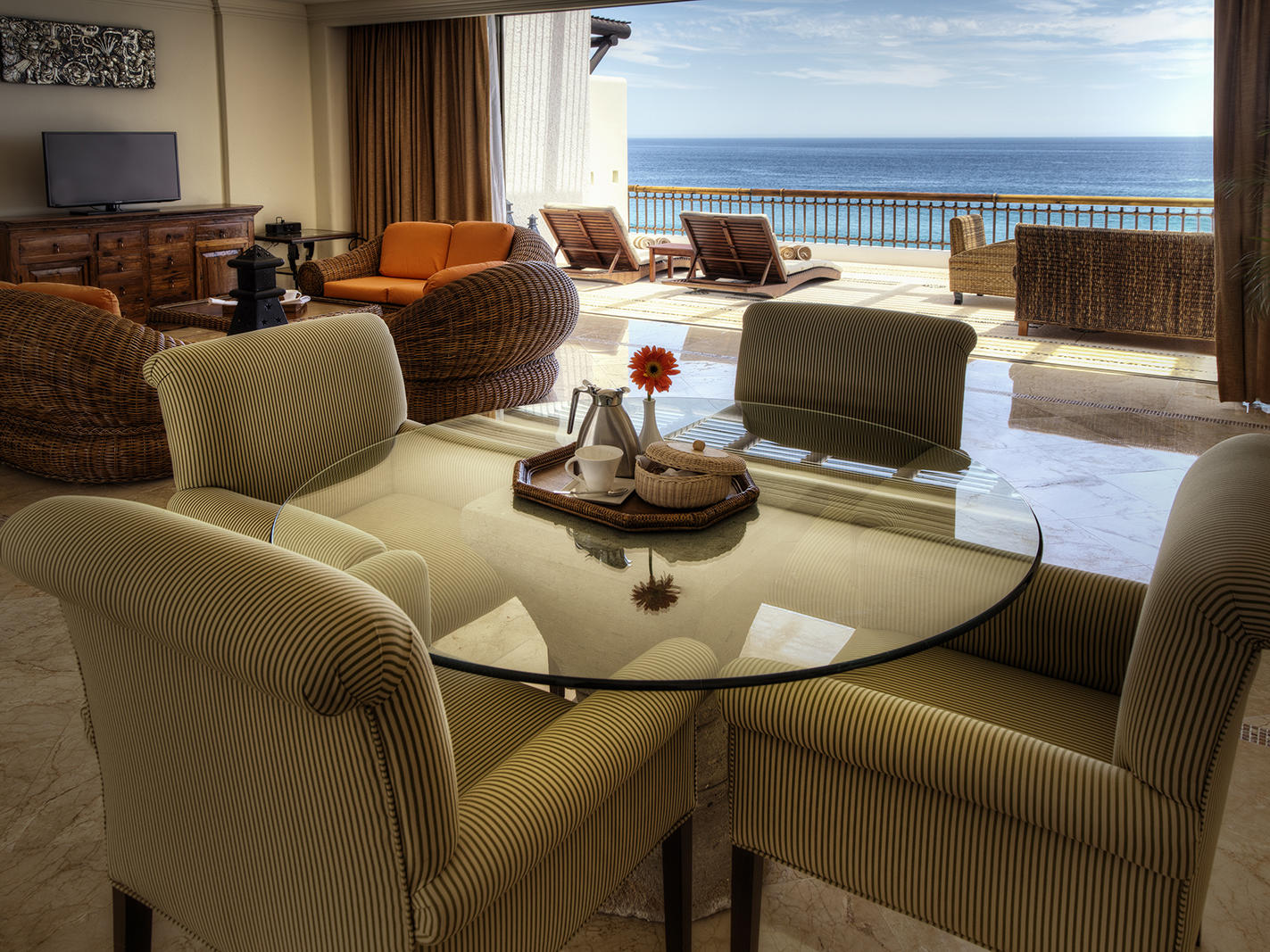 A circular table with chairs - Marquis Los Cabos