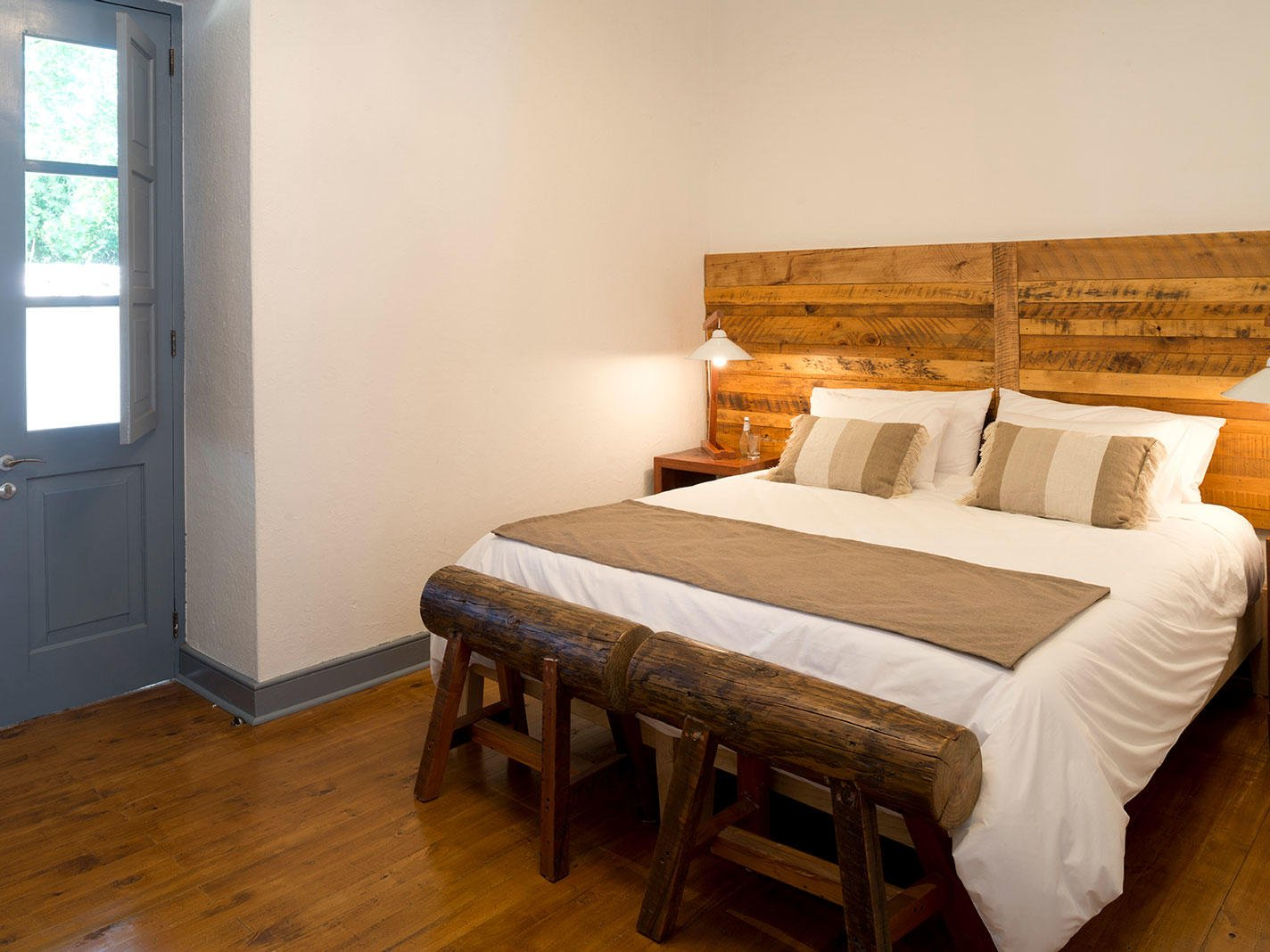 Deluxe King Room bedroom with kingbed at NOI Blend Colchagua