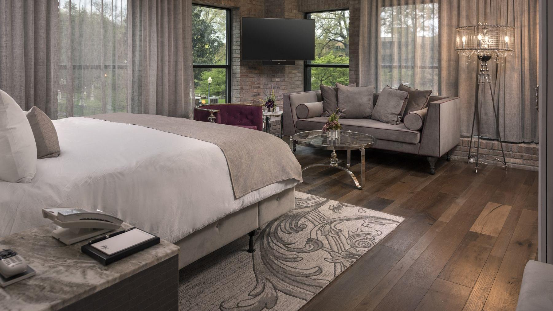 bed with wood floor and sofa