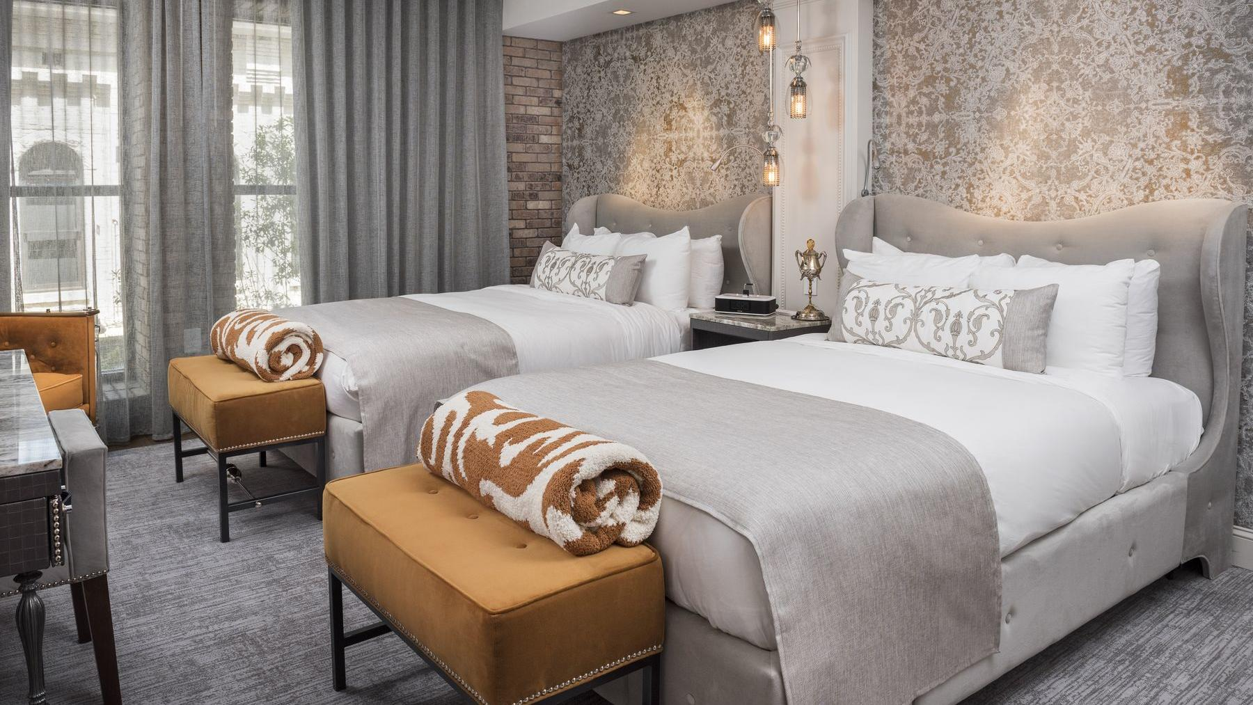 beds in cozy room with carpet and floral headboards
