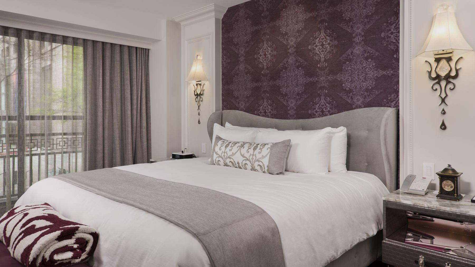 bed in cozy room with floral headboard