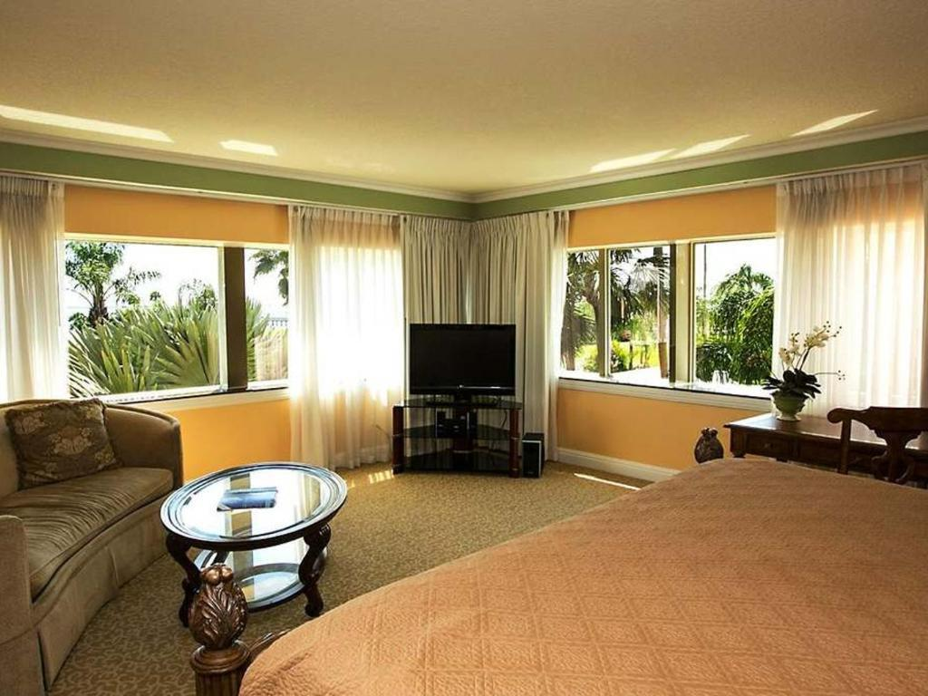 Hotel suite with bay view and king bed.
