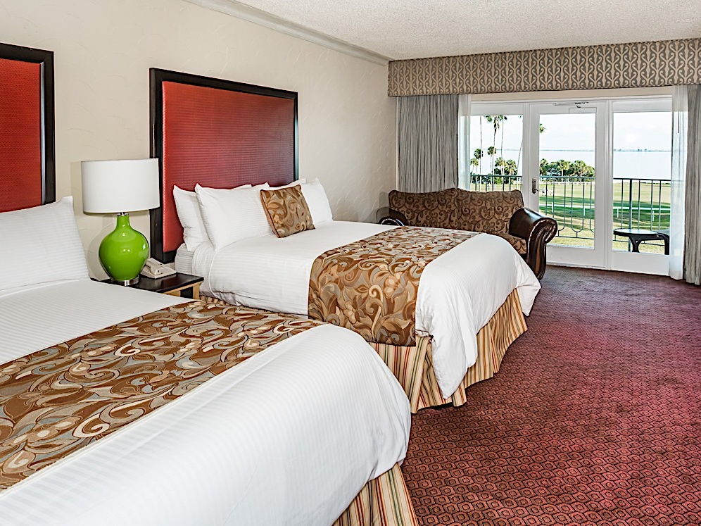 Elegant hotel room with two Queen beds.
