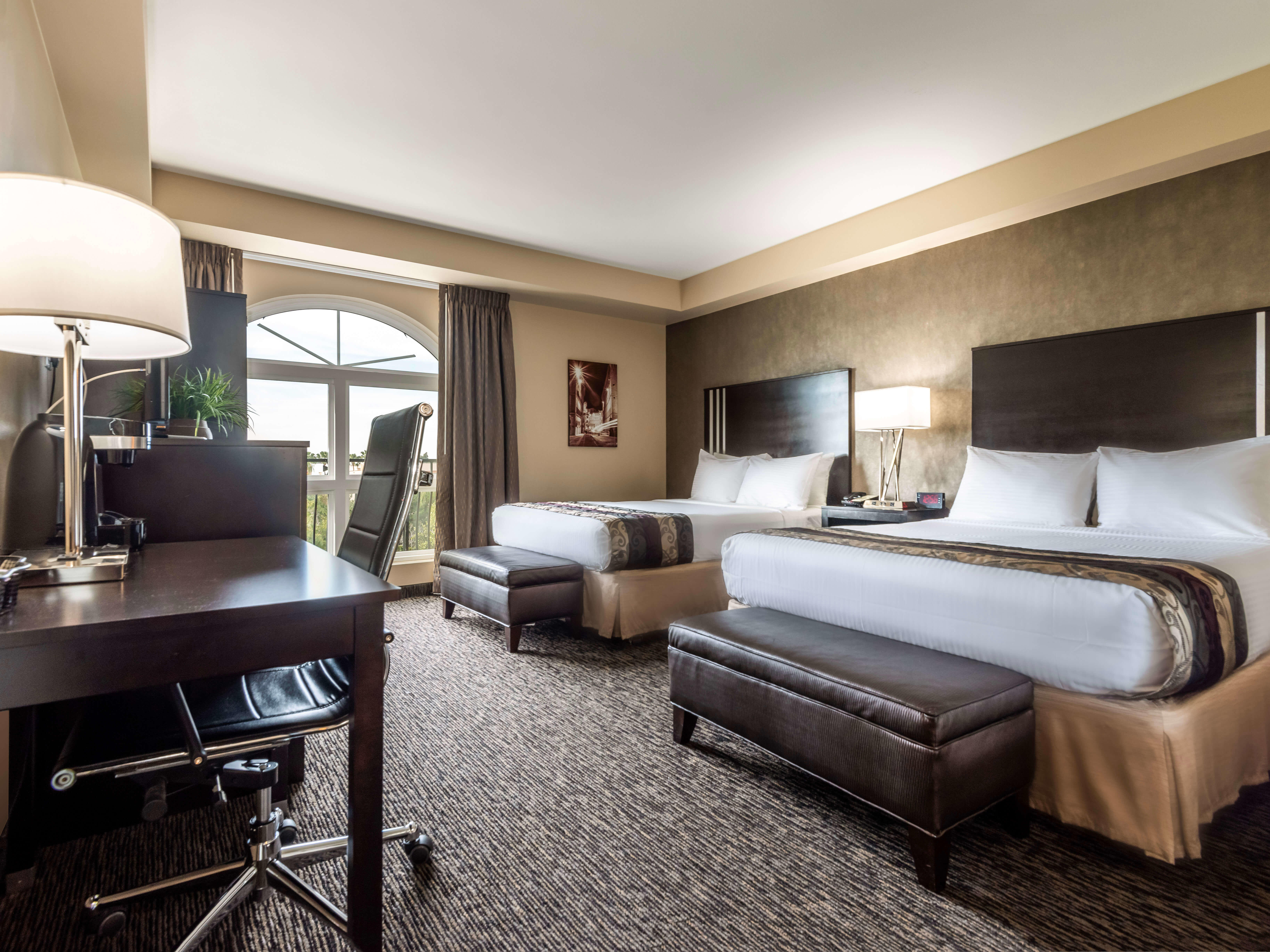 Legacy suite bedroom at Grand Legacy at The Park Anaheim.
