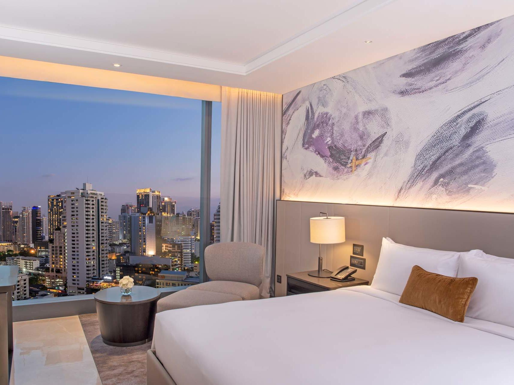 modern guestroom with large windows and city view