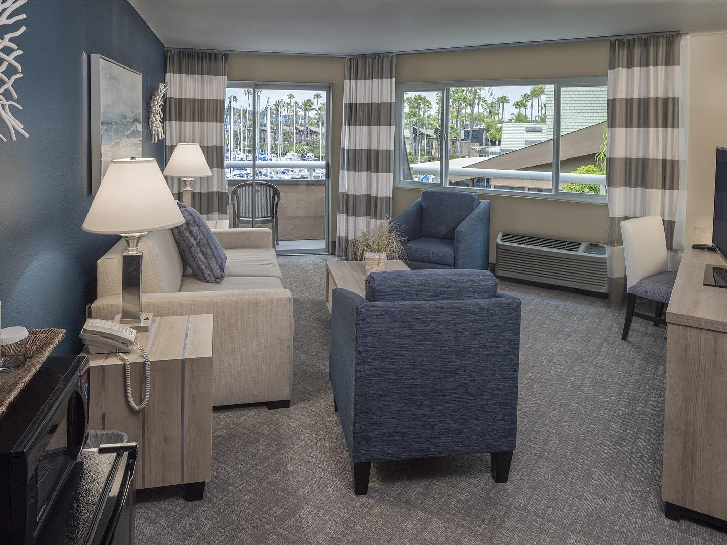 View of One Bedroom Suite living room area at Bay Club Hotel
