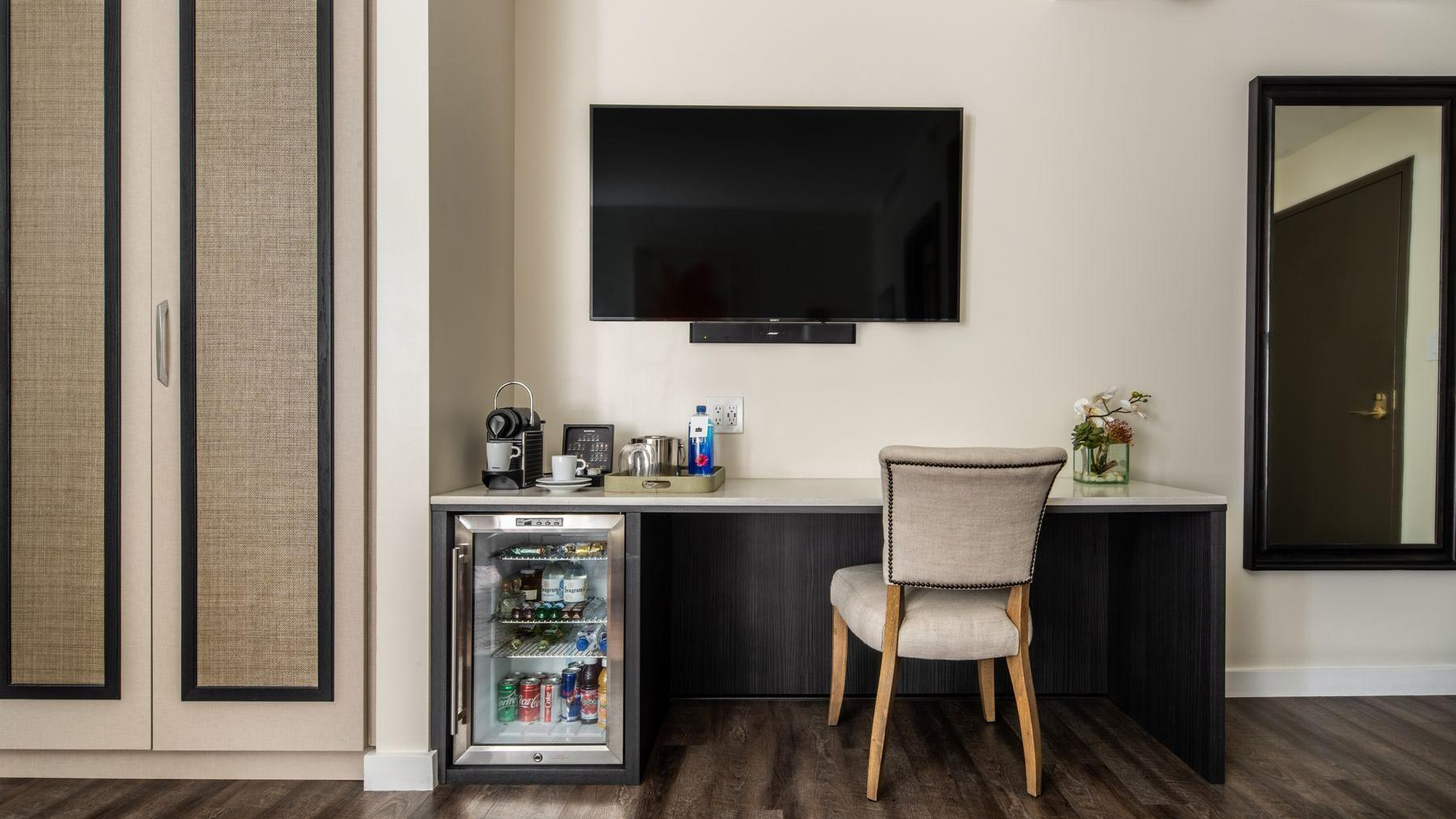 desk with television above