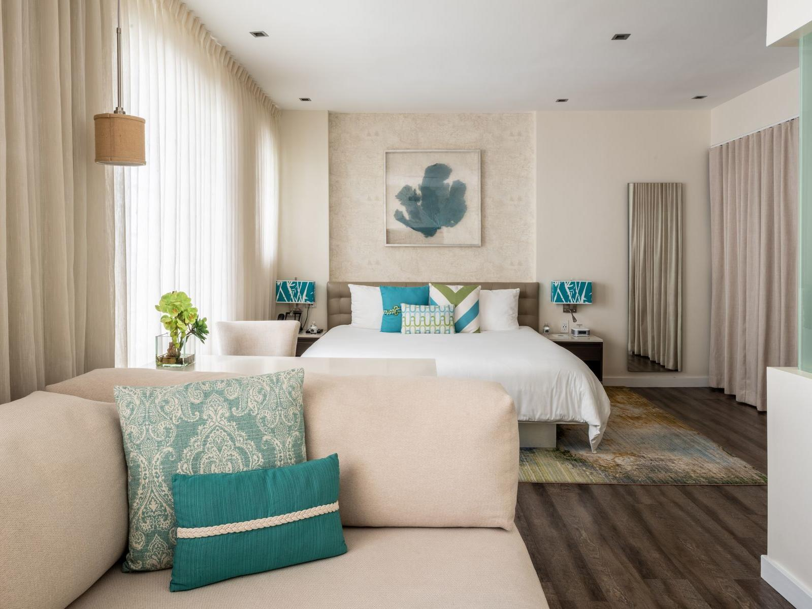 couch and bed in room with blue colors
