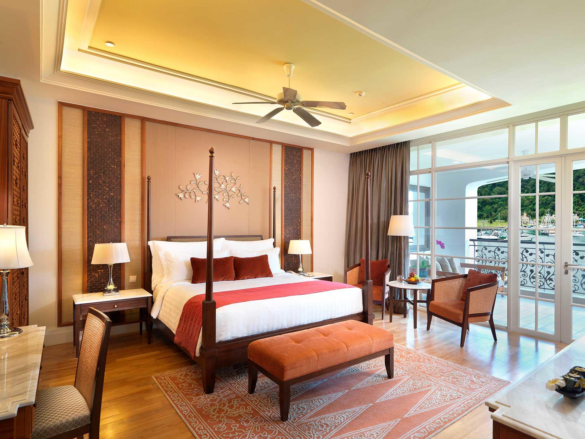 Spacious hotel room with king bed and private balcony