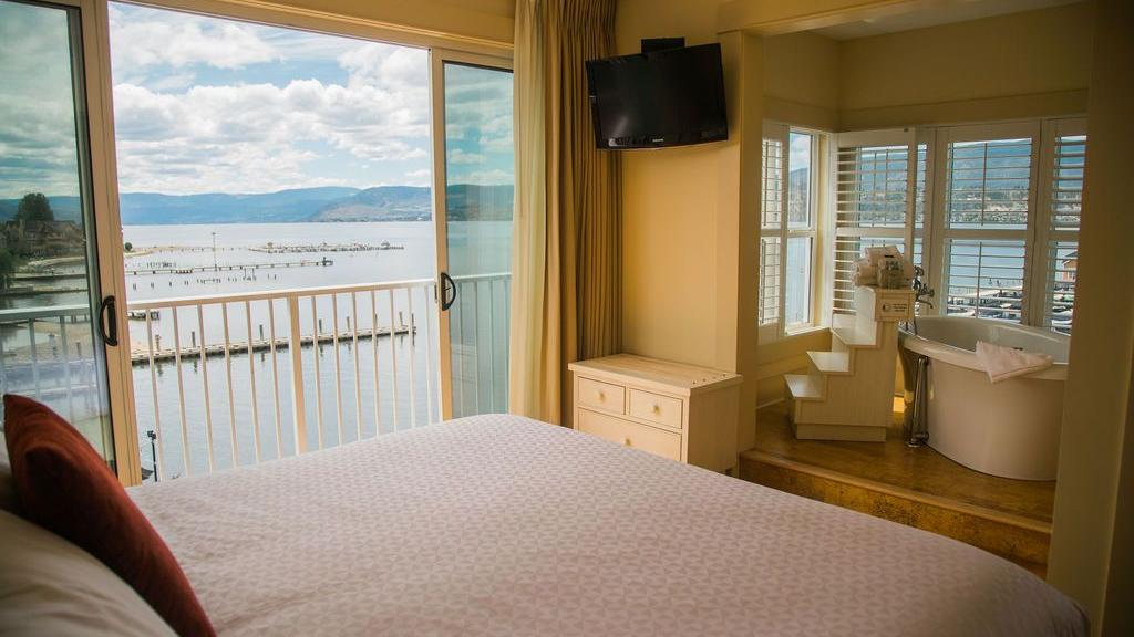 Hotel room with one bed and seaside view.