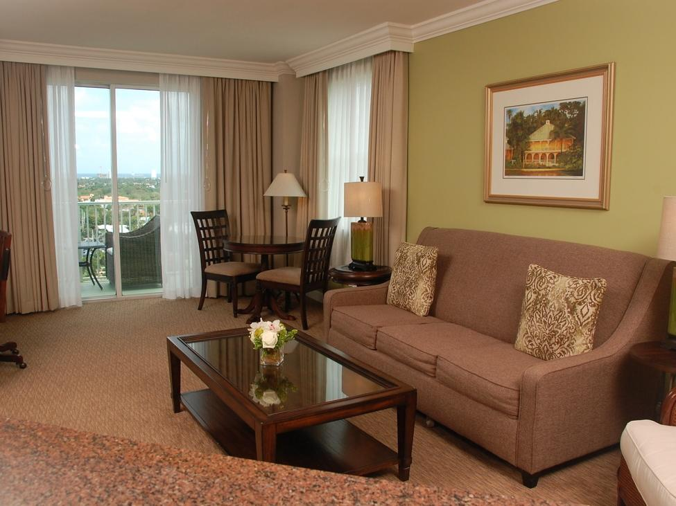 couch and living room area of hotel room