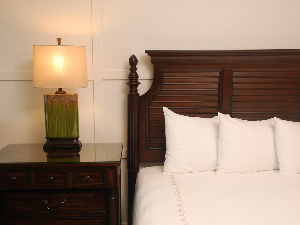 white bed with lamp in hotel room