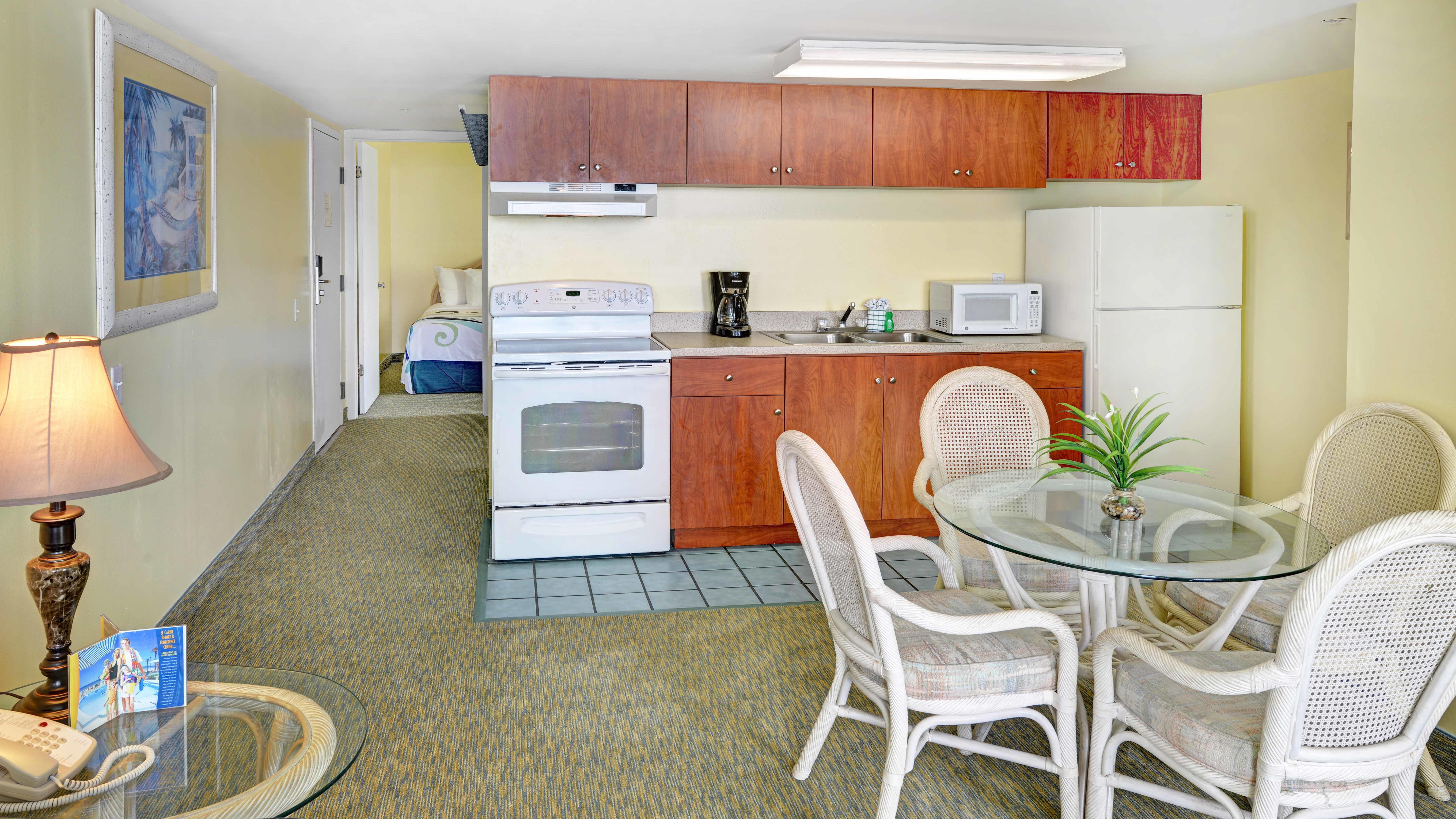 Living and kitchen area of hotel room.