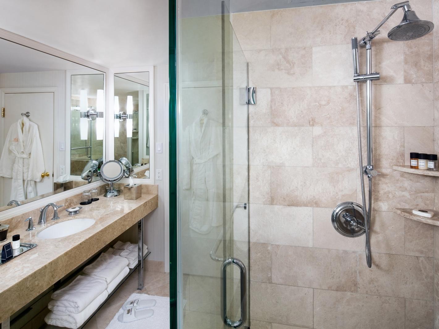 shower and vanity in hotel bathroom