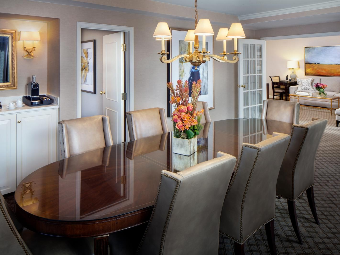 large dining table in hotel room