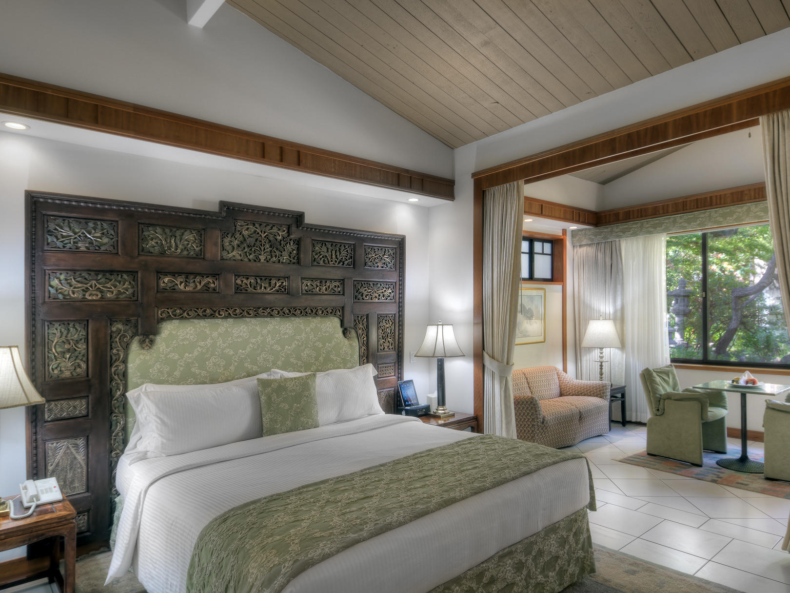 bedroom with white sheets and green decoration