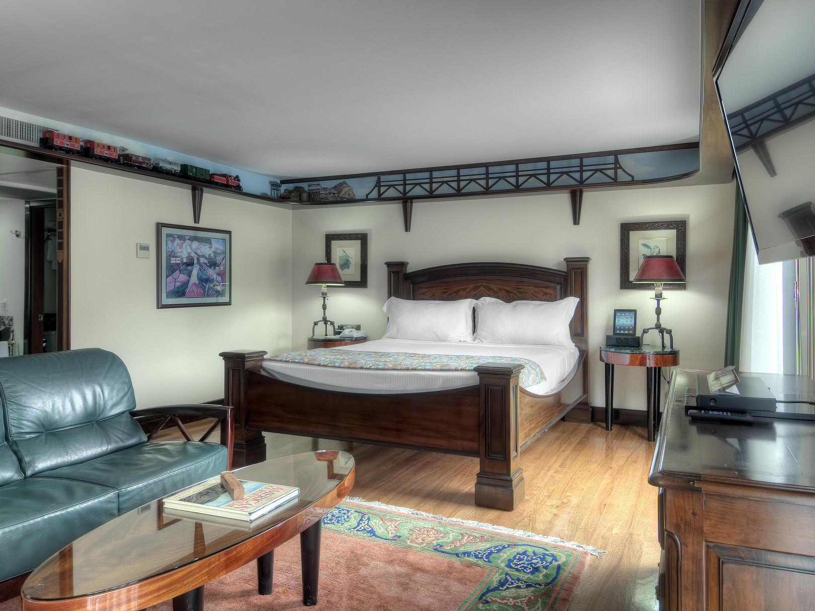 bedroom suite with blue couch and carpet