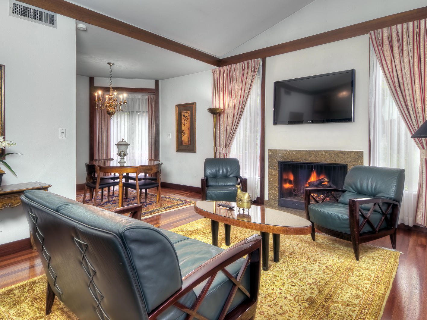 living room area with furniture and fireplace